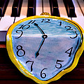 Dripping Clock On Piano Keys by Garry Gay