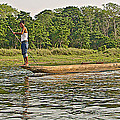 Dugout Canoe In The Rapti River In Chitin National Park-nepal by Ruth Hager
