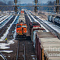 Eastbound And Westbound Trains by Ronald Grogan