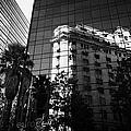 edificio ariztia building reflected in modern bank buildings in the financial district of Santiago Chile by Joe Fox