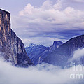 El Capitan Rises Above The Clouds by B Christopher
