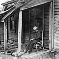 Elderly Man Doses On His Porch by Underwood Archives