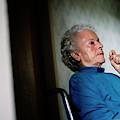 Elderly Woman Sitting In A Wheel Chair by Ron Koeberer
