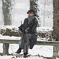 Elegant Woman Sitting On A Bench by Mats Silvan