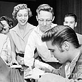 Elvis Presley Signing Autographs For Fans 1956 by The Harrington Collection
