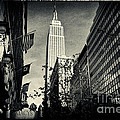 Empire State Building And Macys In New York City by Sabine Jacobs