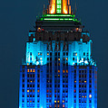Empire State Building Lit Up At Night by Panoramic Images