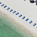 Empty Sun Loungers On A Tropical Beach by Tommy Clarke