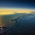 Evening Ocean Shore From The Airplane Window by Viktor Birkus