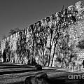 Evora - Portugal - Man And Wall by Carlos Alkmin