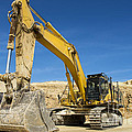 Excavator At Quarry Site by Stuart Renneberg