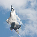 F-22 Raptor Creates Its Own Cloud Camouflage by Nathan Rupert