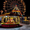 Fairground At Night by Adrian Evans