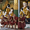 faithful Buddhist monks siiting around Buddha Statues in SHWEDAGON PAGODA by Juergen Ritterbach