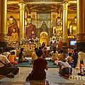 faithful Buddhists praying at Buddha Statues in SHWEDAGON PAGODA Yangon Myanmar by Juergen Ritterbach