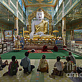 faithful Buddhists praying at sitting Buddha in golden Ponnya Shin Pagoda by Juergen Ritterbach