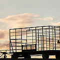 Farm Equipment At Sunset by Tom Bushey