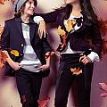 Fashionably Dressed Boy And Teenage Girl Under Falling Autumn Le by Oleksiy Maksymenko