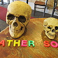 Father And Son - Toy Skulls At The Cafe by David Lovins