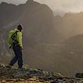 Female Hiker On Summit Of Tverrfjellet by Cody Duncan