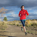 Female Runner In Colorado by Alexandra Simone