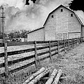 Fence Posts And Barn by John Anderson