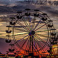 Ferris Wheel Sunset by Jeff Stoddart