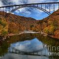 Fiery Colors At New River Gorge Bridge by Adam Jewell