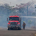 Fire Engine Fighting A Small Fire by Craig Lapsley