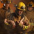 Fire Fighters Rescuing A Baby by Don Hammond