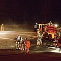 Firefighters At Work by Aaron Martens