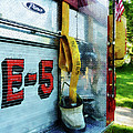 Fireman - Hose In Bucket On Fire Truck by Susan Savad