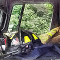 Firemen - Helmet Inside Cab Of Fire Truck by Susan Savad