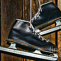 First Pair Of Ice Skates by Paul Ward