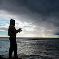 Fisherman Fishing While Storm Blows by Sam Wells