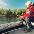 Fisherman Sitting On Foredeck by Marko Radovanovic