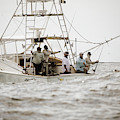 Fishermen Reel In Line From The Back by Chris Ross