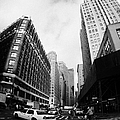 Fisheye Shot Of Yellow Cab On Intersection Of Broadway And 35th Street At Herald Square New York by Joe Fox