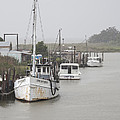 Fishing Boats Along The Docks On Tilghman Island On The Chesapeake Bay In Maryland. by William Kuta
