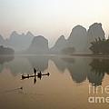 Fishing With Cormorant On Li River by King Wu