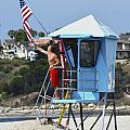 Flag Waving Lifeguard by Floyd Snyder