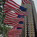 Flags At Rokefeller Plaza by Carol Ailles