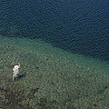 Fly Fishing In Alpine Lake by Topher Donahue