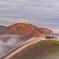 Fog Between Hills At Sunrise by Marc Crumpler