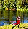 Folding Chair At A Riverbank by Les Palenik