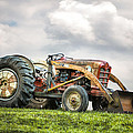 Ford Powermaster Tractor On A Hill by Gary Heller