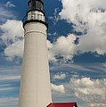 Fort Gratiot Lighthouse And Clouds by Larry Knupp