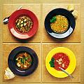 Four Dishes Of Different Food by Ron Nickel