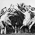 Four Leaping Grecian Dancers by Underwood Archives