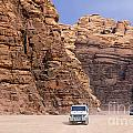 Four Wheel Drive Vehicles At Wadi Rum Jordan by Robert Preston